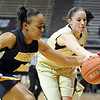 "Jasmyn Otote, left, of Missouri, and Chelsea Dale of CU, reach for a ball going out of bounds.<br /> For more photos of the game, go to  <a href=""http://www.dailycamera.com"">http://www.dailycamera.com</a>.<br /> Cliff Grassmick / January 22, 2011"