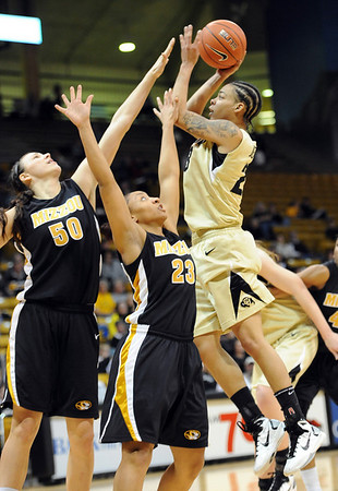 """Chucky Jeffery of CU, shoots over Christine Flores (50) and RaeShara Brown of Missouri.<br /> For more photos of the game, go to  <a href=""""http://www.dailycamera.com"""">http://www.dailycamera.com</a>.<br /> Cliff Grassmick / January 22, 2011"""