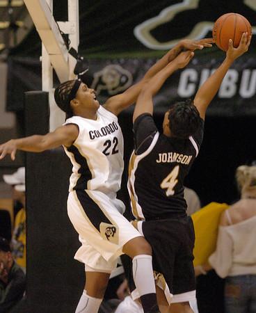 Brittany Spears of CU pressures Jessra Johnson of Missouri.<br /> Cliff Grassmick / January 9, 2010