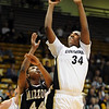Courtney Dunn of CU shoots over Shakara Jones of Missouri.<br /> Cliff Grassmick / January 9, 2010
