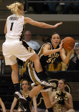 Alyssa Freesle of Colorado plays defense on Christine Flores of Missouri during the first half of the January 9, 2010 game in Boulder.<br /> Cliff Grassmick / January 9, 2010