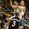 Chucky Jeffery of CU goes up to score over Amanda Hanneman of Missouri.<br /> Cliff Grassmick / January 9, 2010