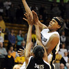 Brittany Spears of Colorado puts up a shot on Shakara Jones of Missouri during the first half of the January 9, 2010 game in Boulder.<br /> Cliff Grassmick / January 9, 2010