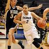 Bianca Smith of Colorado drives around Kendra Frasier of Missouri.<br /> Cliff Grassmick / January 9, 2010