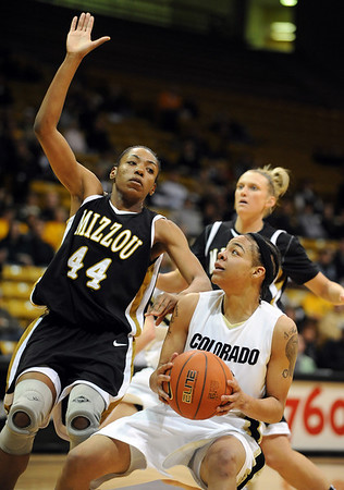 Chucky Jeffery  of Colorado pulls up to shoot over Shakara Jones of Missouri  during the first half of the January 9, 2010 game in Boulder.<br /> Cliff Grassmick / January 9, 2010