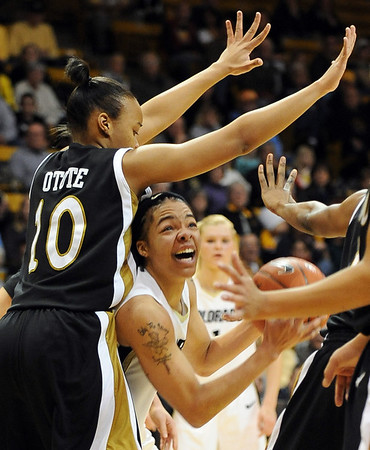 Chucky Jeffery of Colorado looks to score past Jasmyn Otote of Missouri during the first half of the January 9, 2010 game in Boulder.<br /> Cliff Grassmick / January 9, 2010