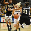 Alyssa Fressle of CU splits the defense of Shakara Jones and Toy Richbow of Missouri.<br /> Cliff Grassmick / January 9, 2010