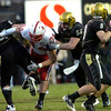 Tyler Hansen (9) gets protection from Mike Iltis (64) and Kennan Stevens (56) as they block Jared Crick (94) during the University of Colorado game against Nebraska on Friday on Folsom Field in Boulder November 27, 2009.<br /> Photo by Paul Aiken / The Camera