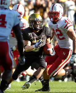 Rodney Stewart (5) breaks past Sean Fisher (42) during the University of Colorado game against Nebraska on Friday on Folsom Field in Boulder November 27, 2009. Photo by Paul Aiken / The Camera
