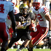 Rodney Stewart (5) breaks past Sean Fisher (42) during the University of Colorado game against Nebraska on Friday on Folsom Field in Boulder November 27, 2009.<br /> Photo by Paul Aiken / The Camera