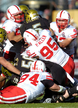 Rodney Stewart (5) is surrounded by Jared Crick (94) Pierre Allen, (95) and Sean Fisher (42)during the University of Colorado game against Nebraska on Friday on Folsom Field in Boulder November 27, 2009.<br /> Photo by Paul Aiken / The Camera