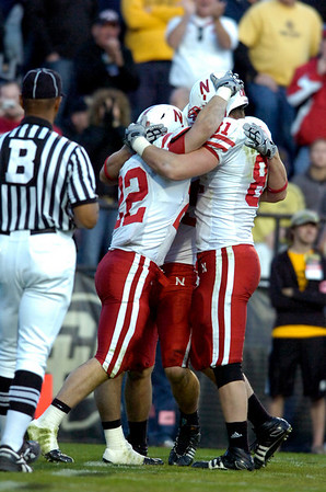Rex Burkhead (22) is surrounded by teammates after his touchdown during the University of Colorado game against Nebraska on Friday on Folsom Field in Boulder November 27, 2009.<br /> Photo by Paul Aiken / The Camera