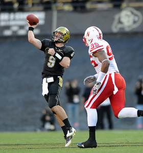 Tyler Hansen of CU gets a pass off against Nebraska.  Cliff Grassmick /November 27, 2009