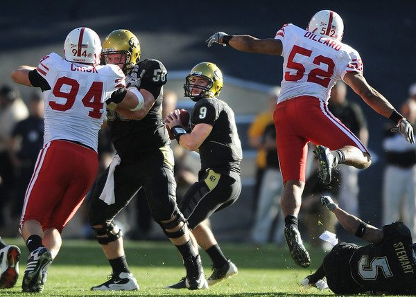Tyler Hansen (9) gets protection from Kennan Stevens (56) as Jared Crick (94) and Phillip Dillard (52) charge in during the University of Colorado game against Nebraska on Friday on Folsom Field in Boulder November 27, 2009.<br /> Photo by Cliff Grassmick / The Camera