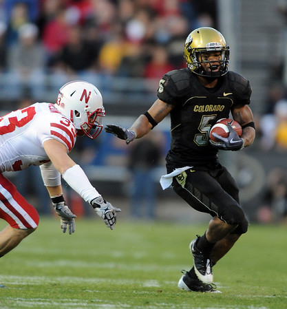 Rodney Stewart of CU  gets  past  Matt O'Hanlon of Nebraska on Friday.<br /> <br /> Cliff Grassmick /November 27, 2009