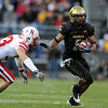 Rodney Stewart of CU  gets  past  Matt O'Hanlon of Nebraska on Friday.<br /> <br /> Cliff Grassmick /November 27, 2009