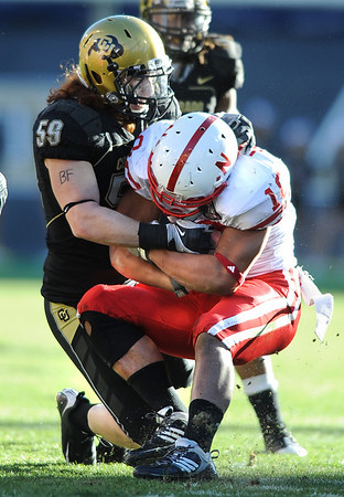 B.J. Beatty (59) wraps up Roy Helu (10)  during the University of Colorado game against Nebraska on Friday on Folsom Field in Boulder November 27, 2009.<br /> Photo by Cliff Grassmick / The Camera