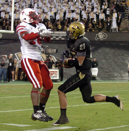 Scotty McKnight, right,  of CU catches his last  touchdown against Nebraska on Friday.<br /> <br /> Cliff Grassmick /November 27, 2009