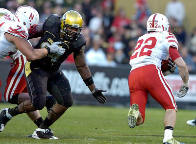 Nate Bonsu (94) tries to get to Rex Burkhead (22) while being blocked by Ricky Henry  (74) during the University of Colorado game against Nebraska on Friday on Folsom Field in Boulder November 27, 2009. Photo by Paul Aiken / The Camera