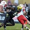 Nate Bonsu (94) gets to Rex Burkhead (22) while being blocked by Ricky Henry  (74) during the University of Colorado game against Nebraska on Friday on Folsom Field in Boulder November 27, 2009.<br /> Photo by Paul Aiken / The Camera