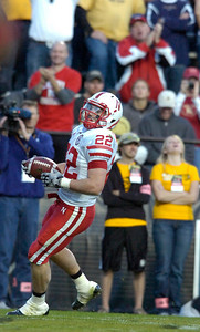 Rex Burkhead enters the endzone for a touchdown as Nebraska fans cheer during the University of Colorado game against Nebraska on Friday on Folsom Field in Boulder November 27, 2009. Photo by Paul Aiken / The Camera