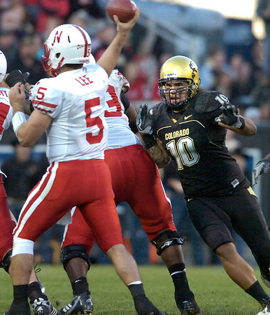 Michael Sipili (10) charges at Zac Lee (5) during the University of Colorado game against Nebraska on Friday on Folsom Field in Boulder November 27, 2009.<br /> Photo by Paul Aiken / The Camera