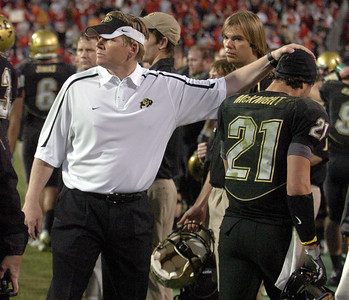 Coach Dan Hawkins pats Scotty McKnight after Scotty's second touchdown. Cliff Grassmick /November 27, 2009