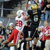Markquez Simas  of Colorado makes a catch over Eric Hagg of Nebraska.<br /> <br /> Cliff Grassmick /November 27, 2009