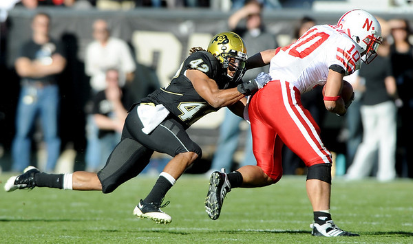 Benjamin Burney (42) grabs Roy Helu (10) during the University of Colorado game against Nebraska on Friday on Folsom Field in Boulder November 27, 2009.<br /> Photo by Cliff Grassmick / The Camera