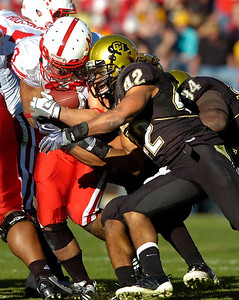 Benjamin Burney (42) puts a shoulder into Roy Helu (10)during the University of Colorado game against Nebraska on Friday on Folsom Field in Boulder November 27, 2009. Photo by Paul Aiken / The Camera