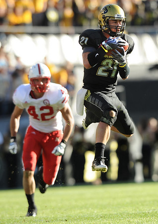 Scotty McKnight (21) makes a leaping grab for a catch during the University of Colorado game against Nebraska on Friday on Folsom Field in Boulder November 27, 2009.<br /> Photo by Cliff Grassmick / The Camera
