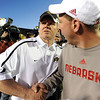 Coach Dan Hawkins congratulates Bo Pelini of Nebraska.<br /> <br /> Cliff Grassmick /November 27, 2009