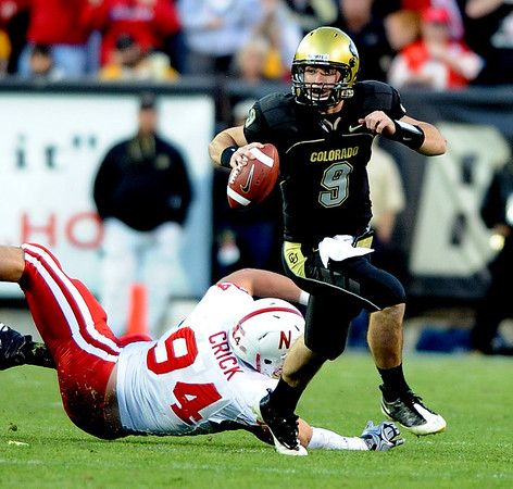 Tyler Hansen of Colorado looks for room to run against Nebraska.<br /> Cliff Grassmick /November 27, 2009