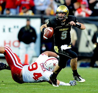 Tyler Hansen of Colorado looks for room to run against Nebraska. Cliff Grassmick /November 27, 2009