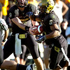 Tyler Hansen (9) hands off to Rodney Stewart (5) during the University of Colorado game against Nebraska on Friday on Folsom Field in Boulder November 27, 2009.<br /> Photo by Paul Aiken / The Camera