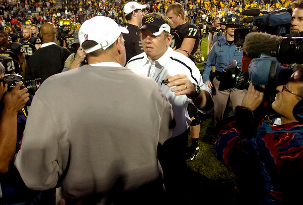 CU Buffs Coach Dan Hawkins greets Nebraska Coach Bo Pelini after the University of Colorado game against Nebraska on Friday on Folsom Field in Boulder November 27, 2009.<br /> Photo by Paul Aiken / The Camera