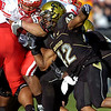 Benjamin Burney (42) puts a shoulder into Roy Helu (10)during the University of Colorado game against Nebraska on Friday on Folsom Field in Boulder November 27, 2009.<br /> Photo by Paul Aiken / The Camera
