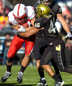 Anthony Perkins (46) stands up Roy Helu (10) during the University of Colorado game against Nebraska on Friday on Folsom Field in Boulder November 27, 2009. Photo by Paul Aiken / The Camera