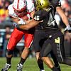 Anthony Perkins (46) stands up Roy Helu (10) during the University of Colorado game against Nebraska on Friday on Folsom Field in Boulder November 27, 2009.<br /> Photo by Paul Aiken / The Camera