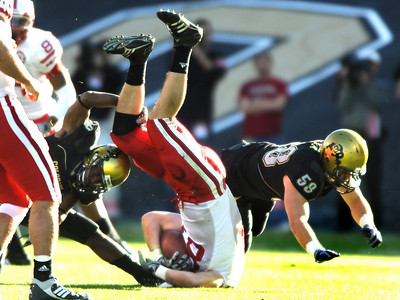 Cha'pelle Brown (29)  upends Brandon Kinnie  (84) )during the University of Colorado game against Nebraska on Friday on Folsom Field in Boulder November 27, 2009. Photo by Cliff Grassmick / The Camera