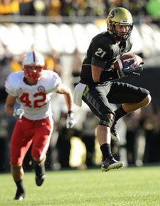 Scotty McKnight (21) makes a leaping grab for a catch during the University of Colorado game against Nebraska on Friday on Folsom Field in Boulder November 27, 2009. Photo by Cliff Grassmick / The Camera