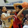 Cory Higgins, left, of Colorado, defends Lance Jeter of Nebraska during the first half of the March 5, 2011 game in Boulder.<br /> Cliff Grassmick / March 5, 2011