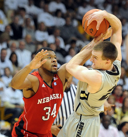 """Lance Jeter of Nebraska pressures Levi Knutson of Colorado during the first half of the March 5, 2011 game in Boulder.<br /> For more photos of the game, go to  <a href=""""http://www.dailycamera.com"""">http://www.dailycamera.com</a>.<br /> Cliff Grassmick / March 5, 2011"""