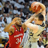 "Lance Jeter of Nebraska pressures Levi Knutson of Colorado during the first half of the March 5, 2011 game in Boulder.<br /> For more photos of the game, go to  <a href=""http://www.dailycamera.com"">http://www.dailycamera.com</a>.<br /> Cliff Grassmick / March 5, 2011"