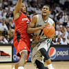 "Cory Higgins of CU drives past Brandon Richardson of Nebraska.<br /> For more photos of the game, go to  <a href=""http://www.dailycamera.com"">http://www.dailycamera.com</a>.<br /> Cliff Grassmick / March 5, 2011"