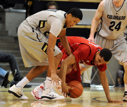 Andre Roberson, left,  of Colorado, and Toney McCray of Nebraska , battle for a loose ball in the first half of the March 5, 2011 game in Boulder.<br /> Cliff Grassmick / March 5, 2011