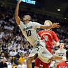Alec Burks of Colorado drives past Drake Beranek of Nebraska during the first have of the March 5, 2011 game in Boulder.<br /> Cliff Grassmick / March 5, 2011
