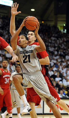 "Andre Roberson of Colorado drives past Jorge Brian Diaz of Nebraska in the first half of the March 5, 2011 game in Boulder.<br /> For more photos of the game, go to  <a href=""http://www.dailycamera.com"">http://www.dailycamera.com</a>.<br /> Cliff Grassmick / March 5, 2011"