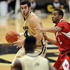 Casey Crawford of CU looks to pass with Myles Holley of NU on him.<br /> Cliff Grassmick / January 27, 2010