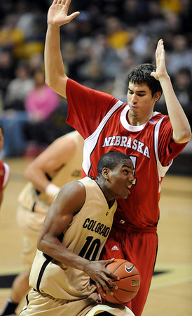 Alec Burks of CU drives to the basket on Jorge Diaz of Nebraska.<br /> Cliff Grassmick / January 27, 2010